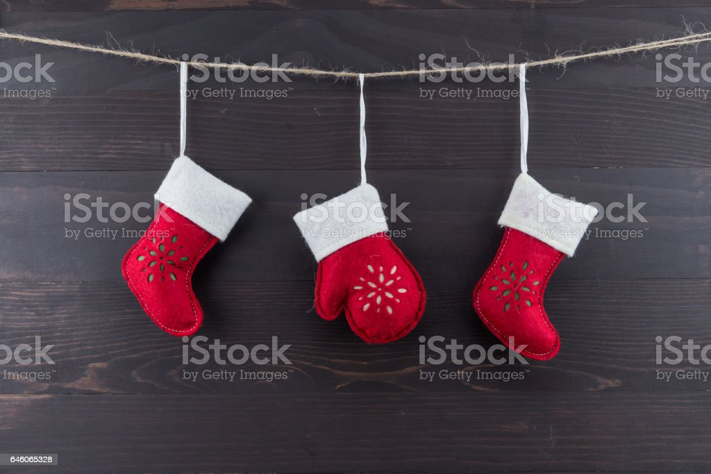 Three Red and White Felt Ornaments stock photo