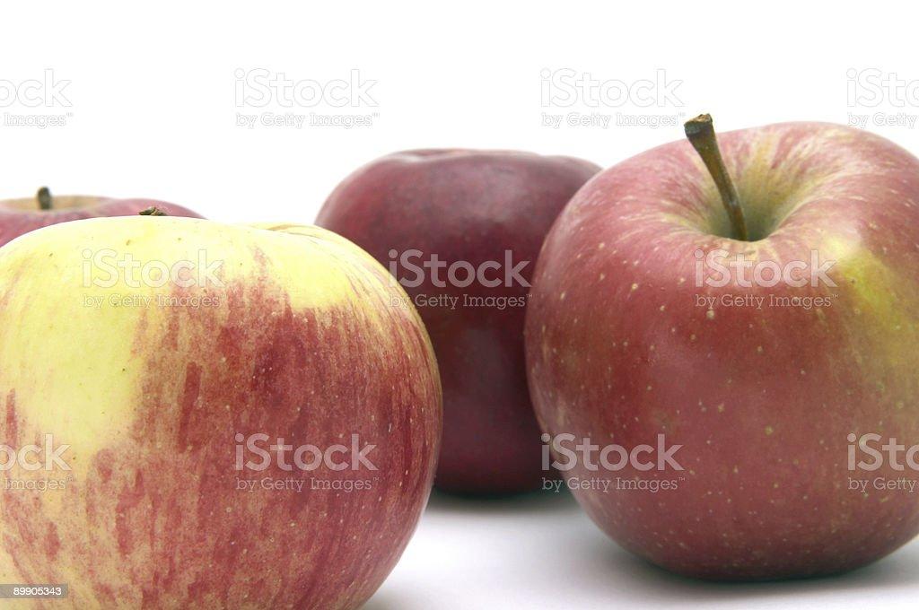 Три красные яблоки Стоковые фото Стоковая фотография