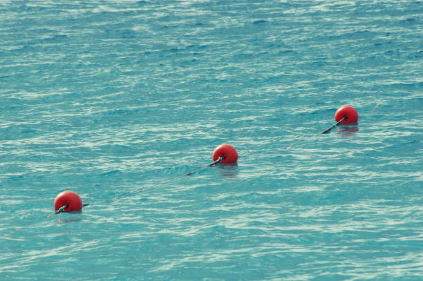 three red bouys by the blue sea - foto stock