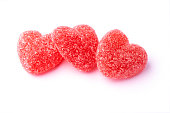 Three red candy hearts on white background