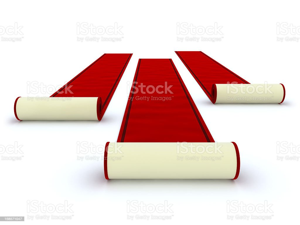 Three red carpets being unrolled stock photo