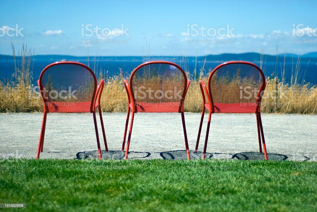 Three Red Chairs stock photo