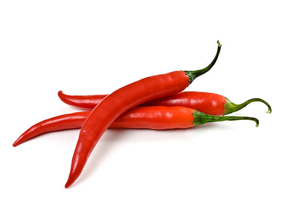 three red chili peppers on a white background - rode chilipeper stockfoto's en -beelden