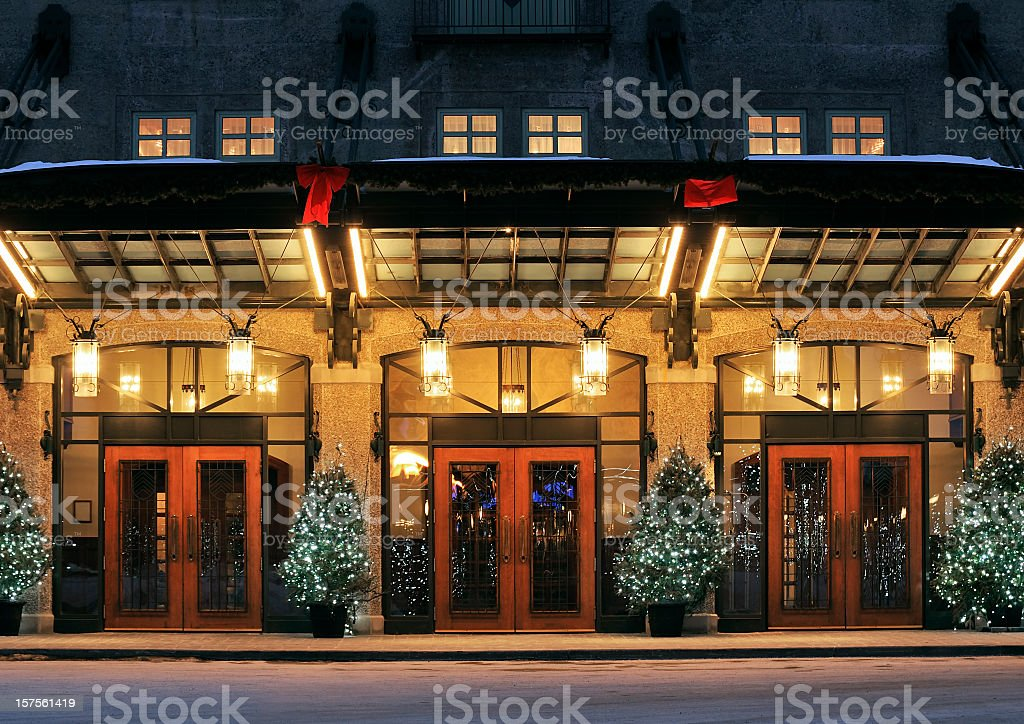 Three red door entrances to the same building stock photo