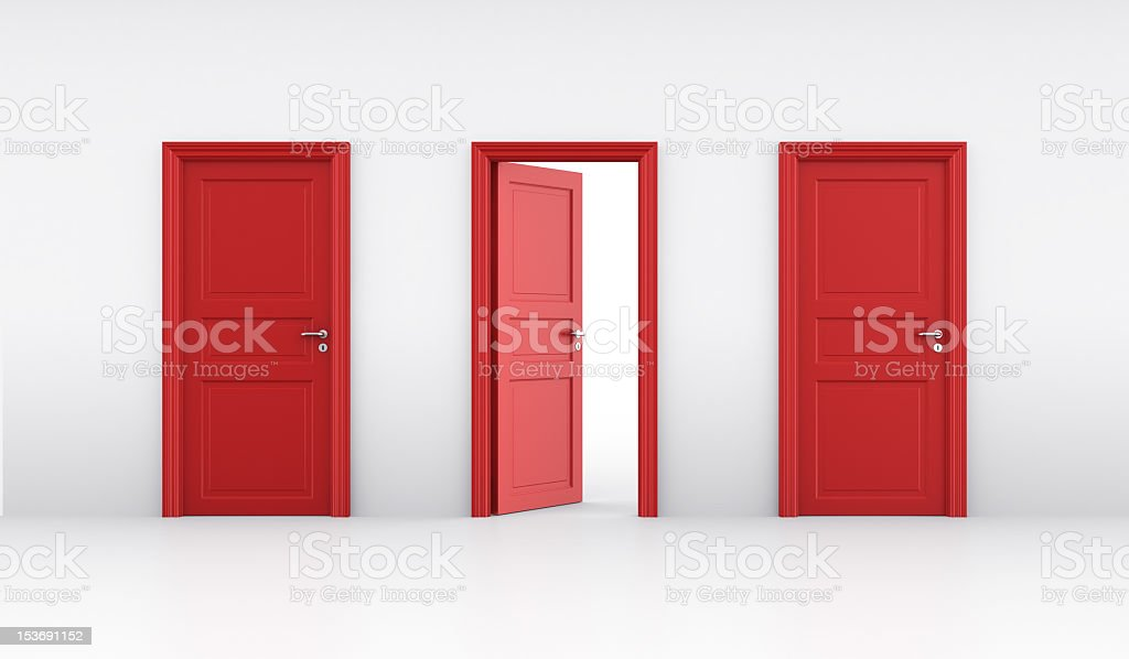 Three red doors in a line with the middle slightly ajar stock photo