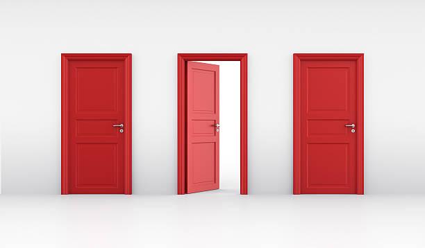 three red doors in a line with the middle slightly ajar - kapı stok fotoğraflar ve resimler