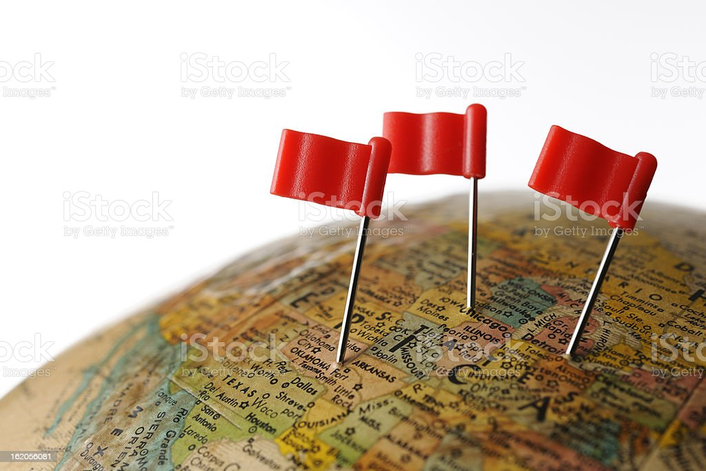 Three red flag pushpin on globe against white background stock photo
