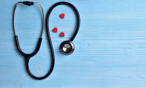 Three Red hearts with stethoscope. stock photo