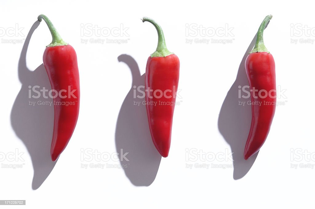 Three Red Hot Peppers royalty-free stock photo