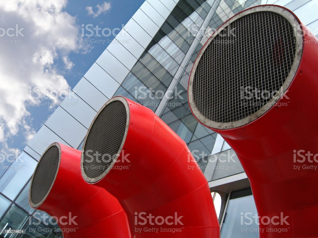 Three red industrial pipes royalty-free stock photo