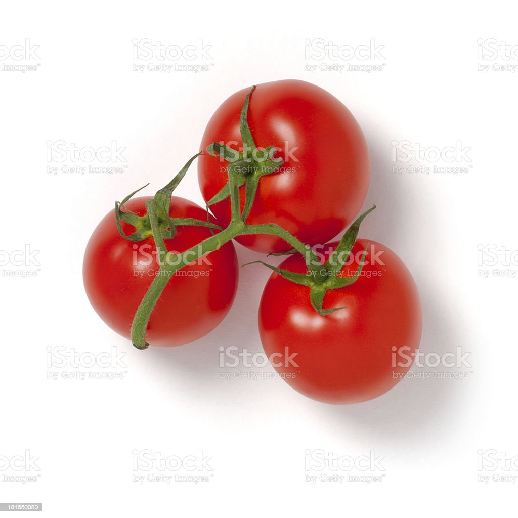 Three red little 'ciliegino' tomatoes on white background stock photo