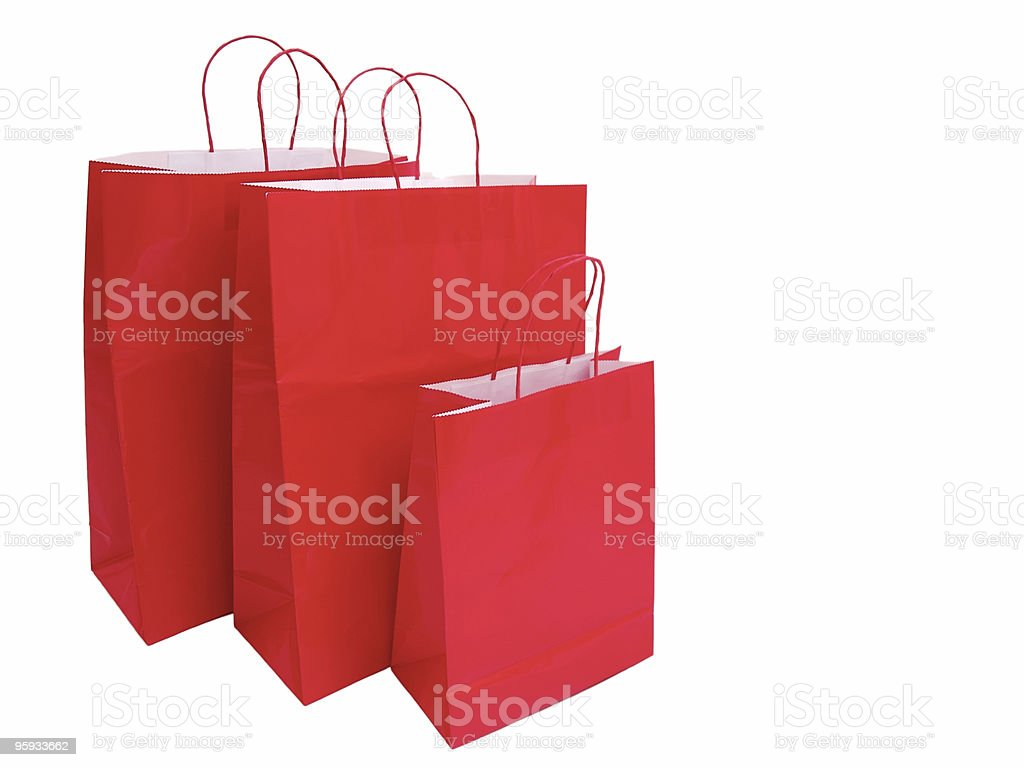 Three red shopping bags on a white background royalty-free stock photo