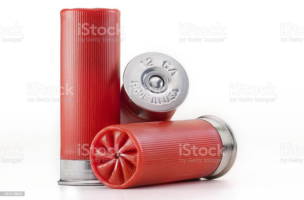 Three red shotgun shells on isolated white background stock photo