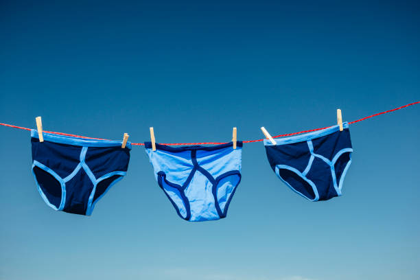 three retro y-fronts on a washing line against blue sky. - washing line stock photos and pictures