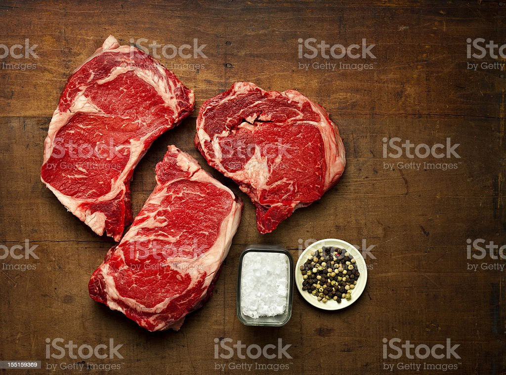 three rib-eye steaks stock photo
