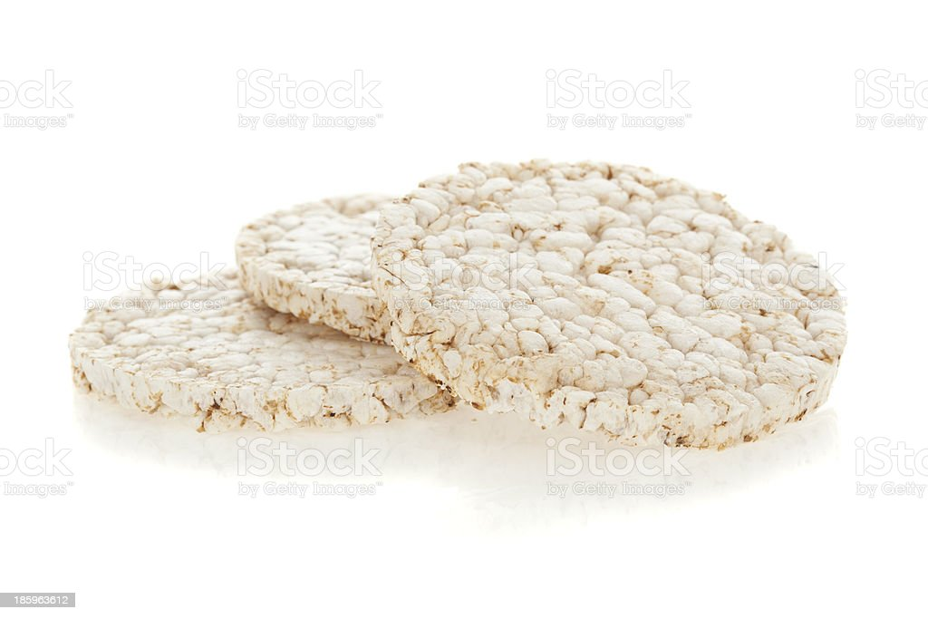 Three rice cakes piled on a white background stock photo
