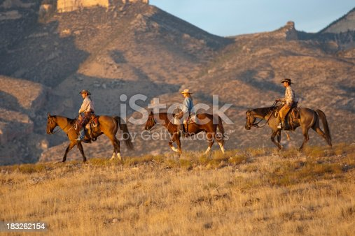 Three riders in high country of Wyoming walk horses along ridgeline.Click on the following banner to see more images: