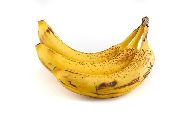 Three ripe bananas stock photo