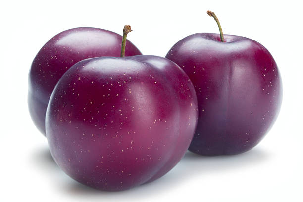 Three ripe plums isolated on a white background stock photo