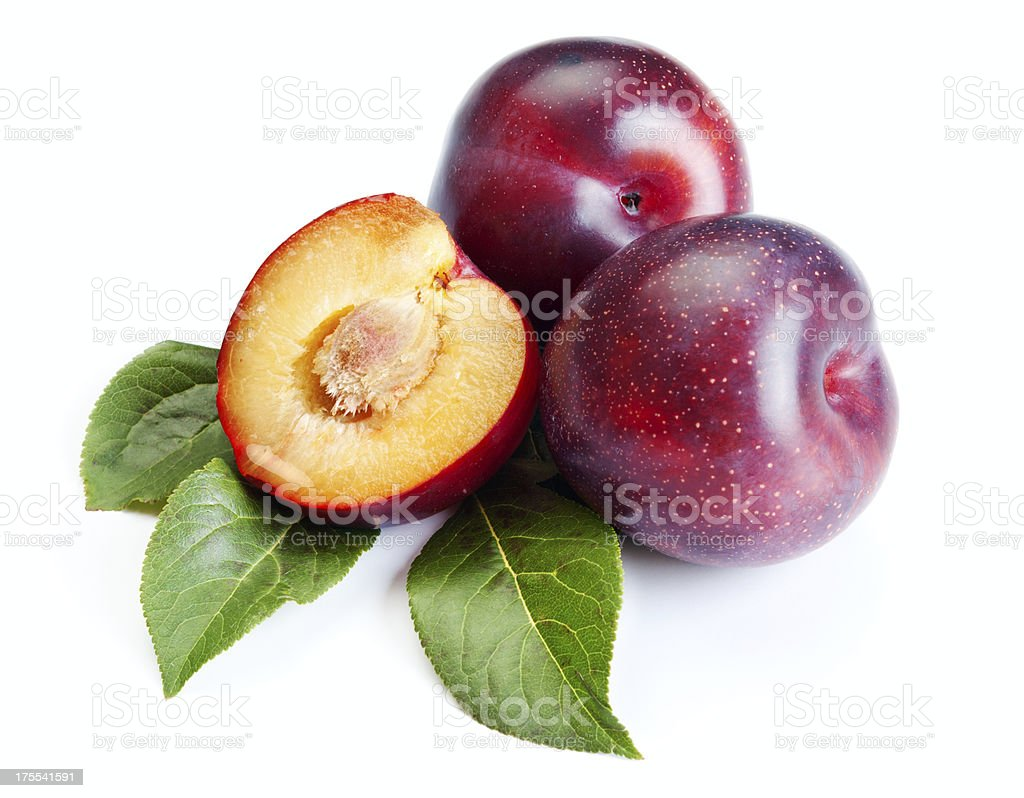 Three ripe plums on white background stock photo