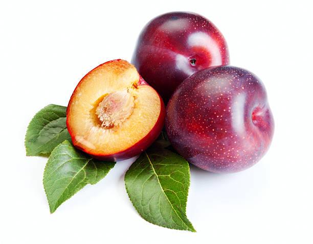 Three ripe plums on white background stock photo
