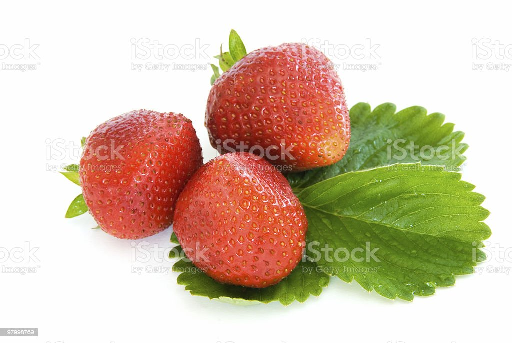 Three ripe red strawberries and a leaf on white royalty-free stock photo