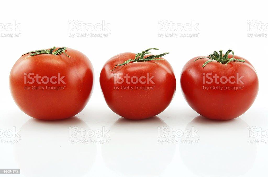 Three Ripe Tomatoes Isolated on White royalty-free stock photo