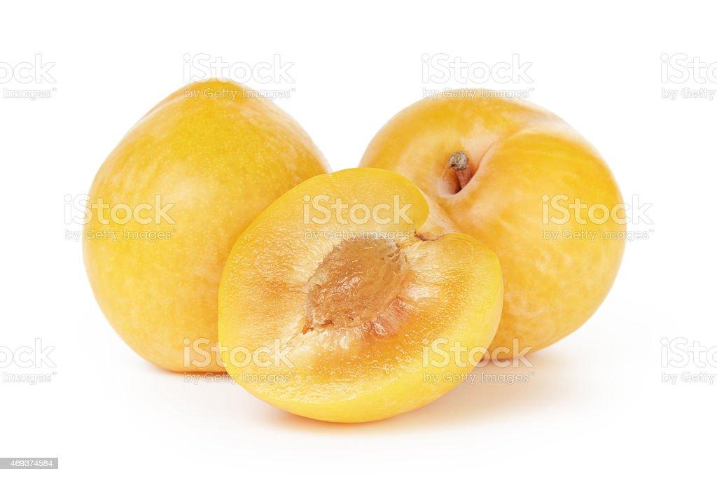 three ripe yellow plums stock photo