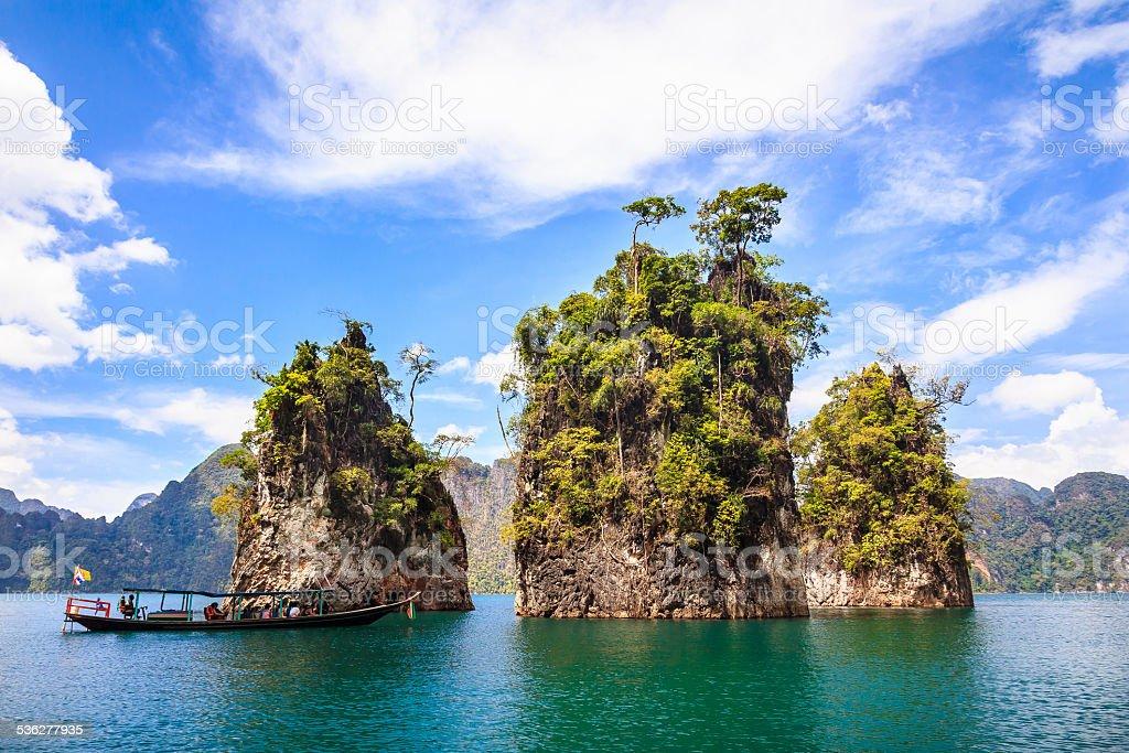Three rocks in Cheow Lan Lake stock photo
