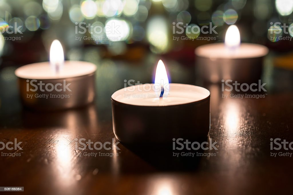 Three Romantic Tea Lights For Dinner With Bokeh At Night stock photo