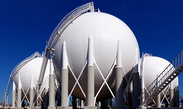Three round holding tanks at petrochemical plant stock photo