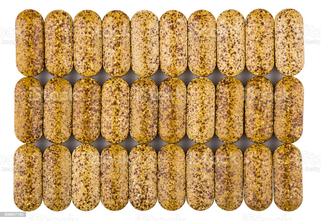 Three row of brown spotted vitamins isolated on white stock photo