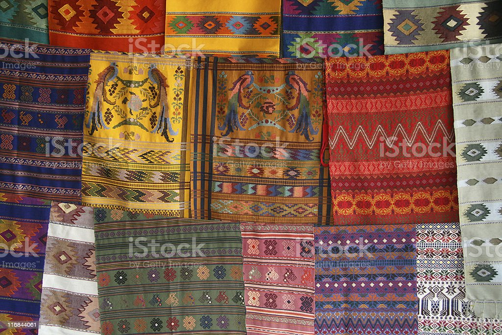 Three rows of colorful printed fabric in Guatemala for sale stock photo
