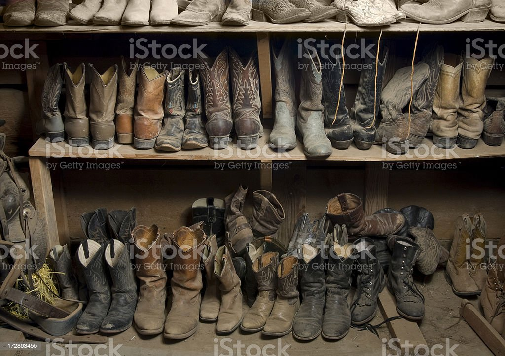 8204b0a1acb Three Rows Of Many Pairs Of Worn Cowboy Boots Stock Photo - Download ...
