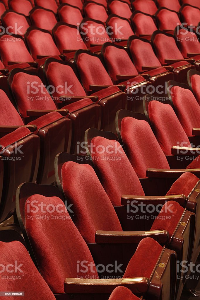 Three rows of red theater seats royalty-free stock photo
