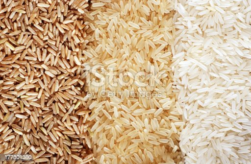 istock Three rows of rice varieties - brown, wild and white. 177301360