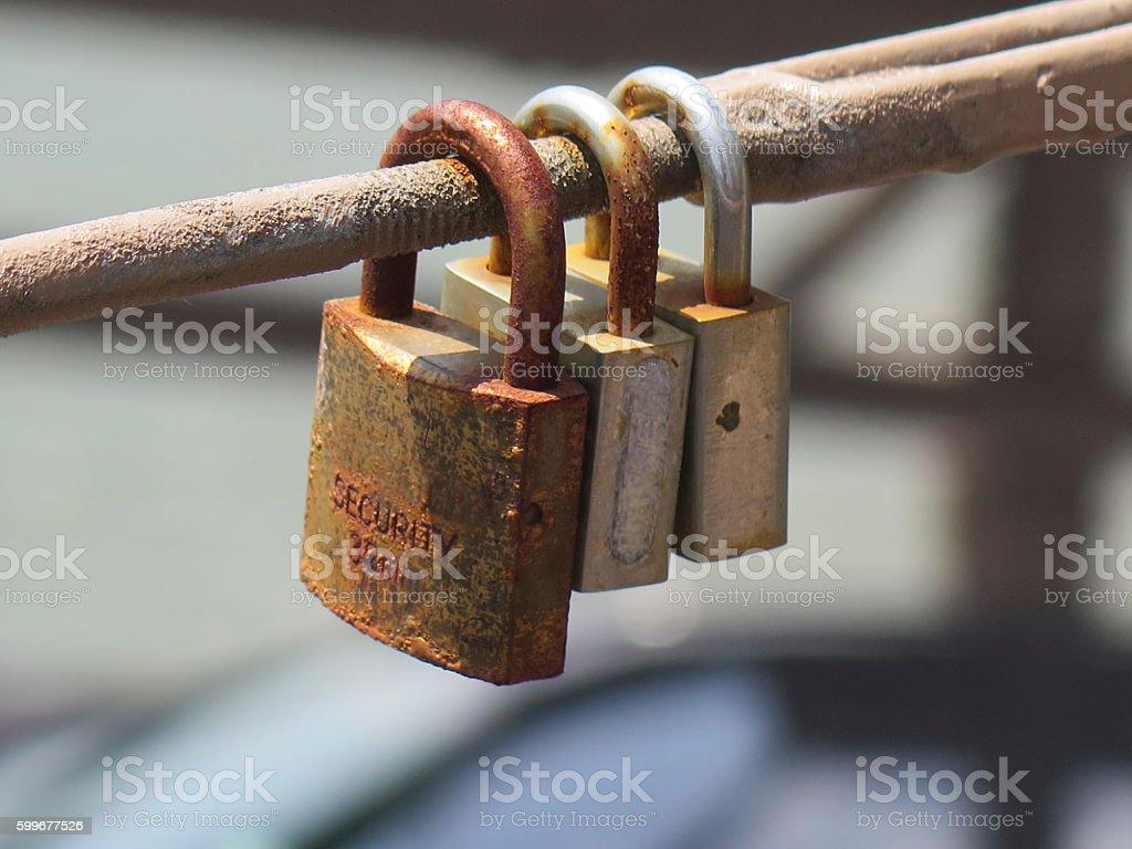 Three rusty padlocks stock photo