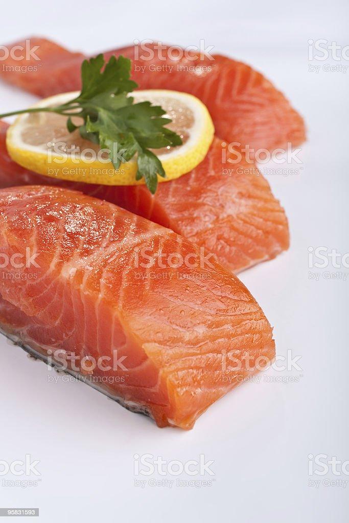 three salmon pieces on white background royalty-free stock photo