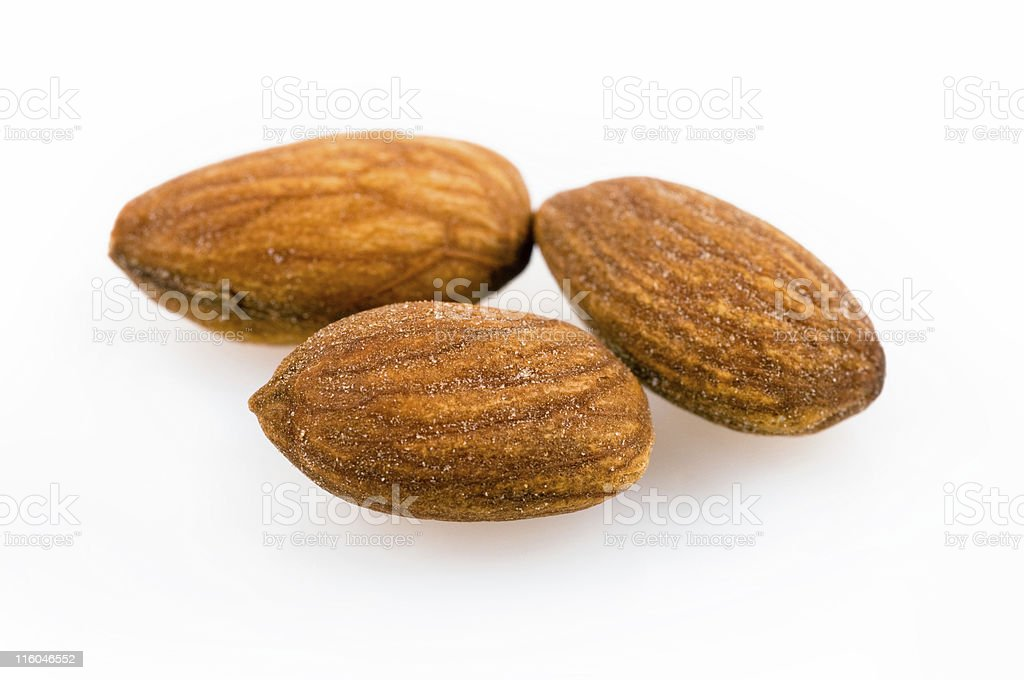 three salted almonds stock photo