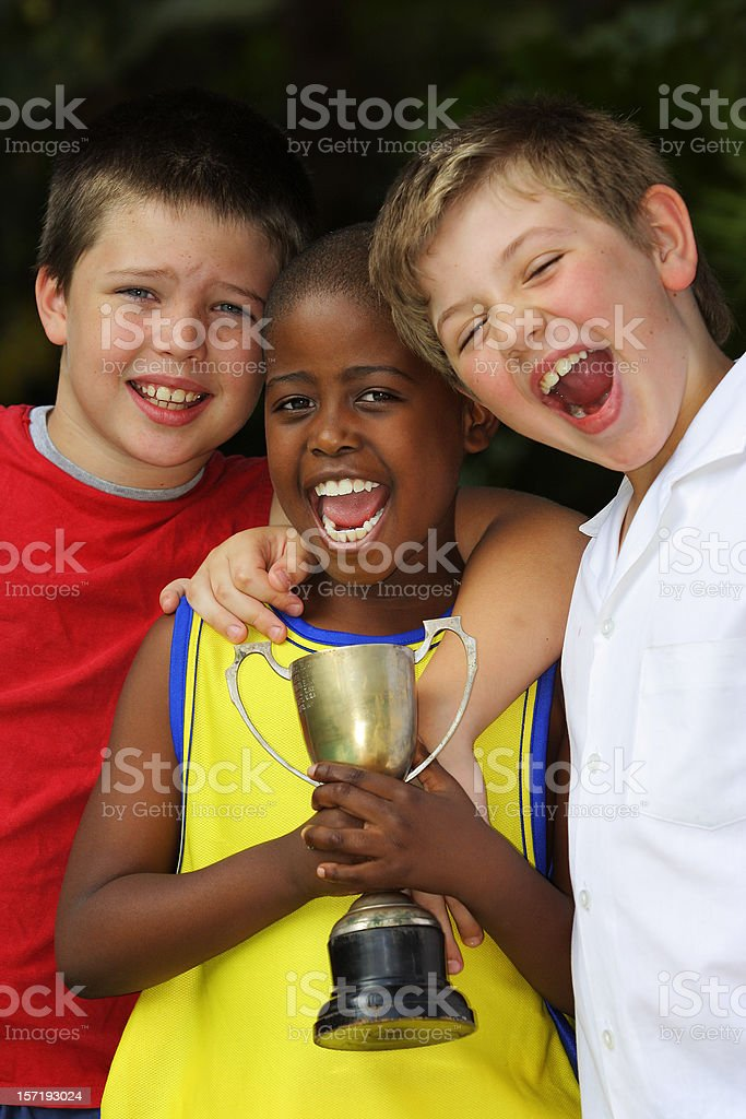 Three Schoolboys Celebrating royalty-free stock photo