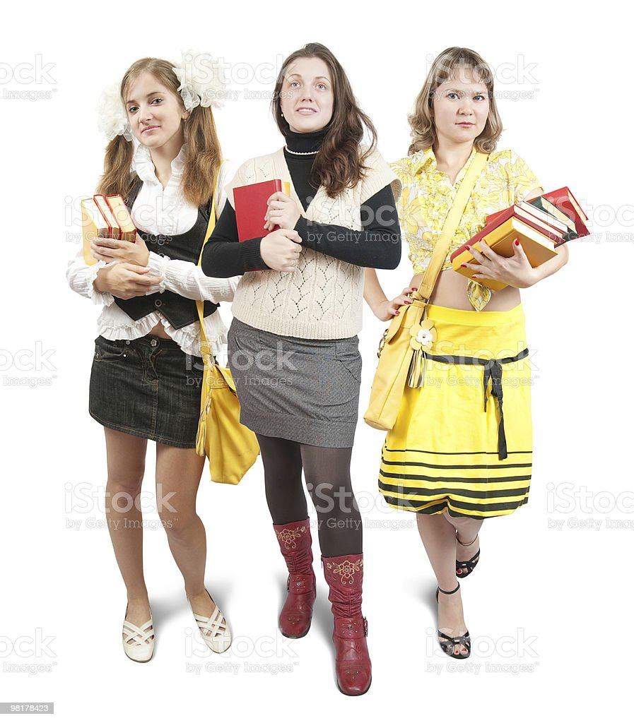 three schoolgirls or students with books royalty-free stock photo
