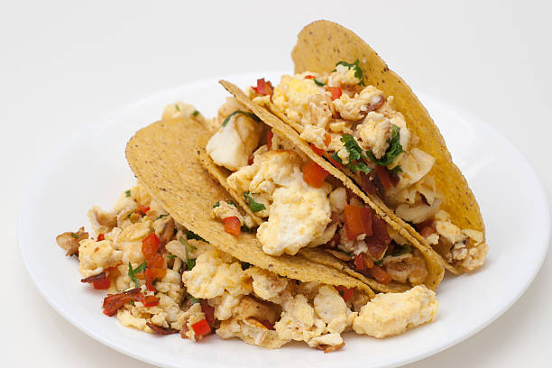 three scrambled egg tacos stock photo