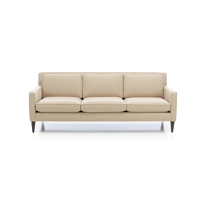 Classic formal sofa for three seats, isolated.Three seats cozy color fabric sofa isolated on white.