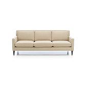 istock Three seats cozy color fabric sofa isolated on white. 1226422248