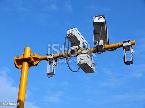 istock three security cameras on yellow pole with blue sky background 503766656