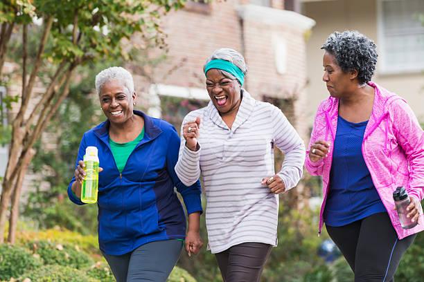 Three senior black women exercising together stock photo