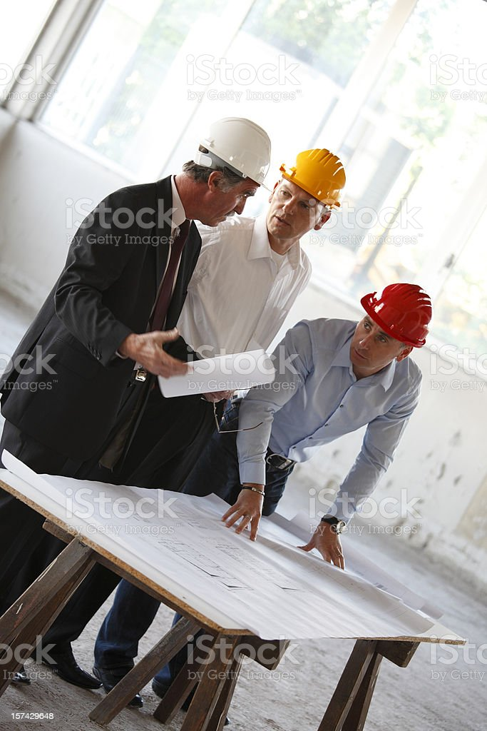 Three senior business men at construction site royalty-free stock photo