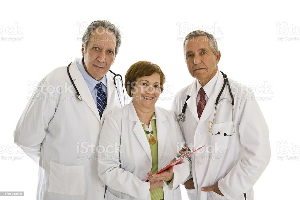Three senior doctors looking at camera one female two males royalty-free stock photo