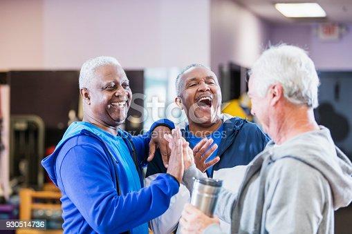 istock Three senior men hanging out at gym, talking 930514736