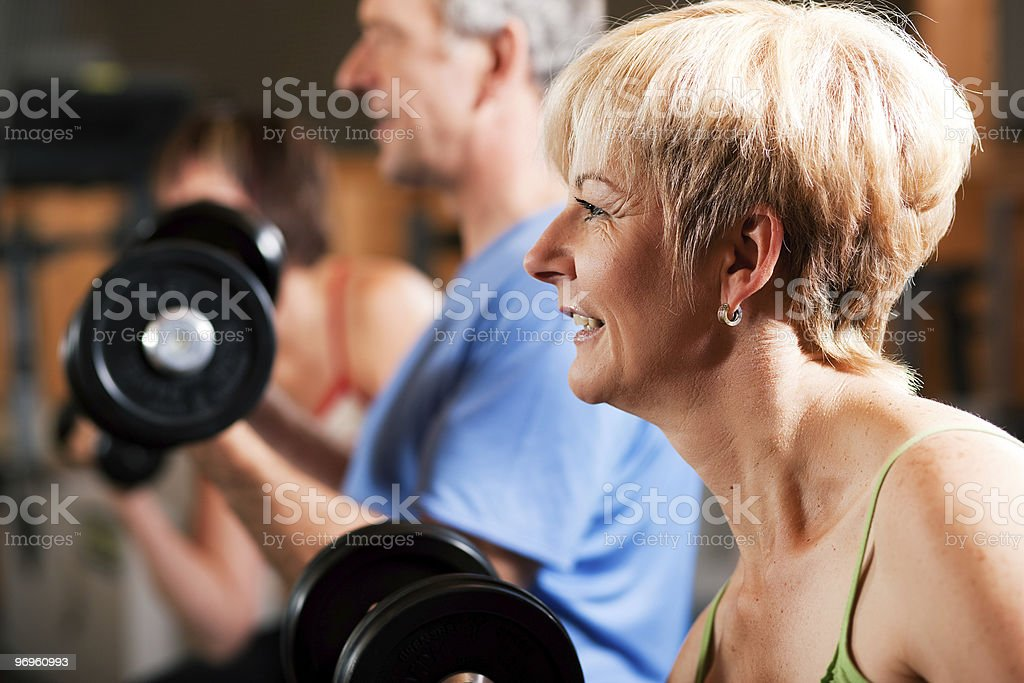 Three senior people in gym stock photo